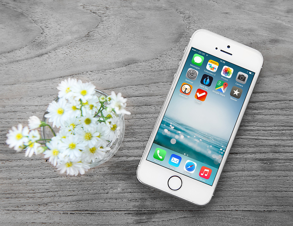 Free iPhone Mockup with Wooden Background