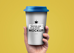 Free Coffee Cup In Hand Mockup