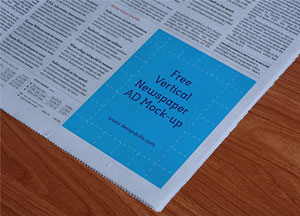 Free Newspaper Vertical Ad Mockup PSD