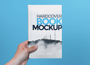 Free Hardcover Book In Hand Mock-up