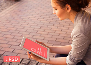 Free Girl Holding Apple iPad Mock-up Psd