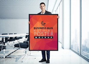 Free Man Holding Poster MockUp in Office