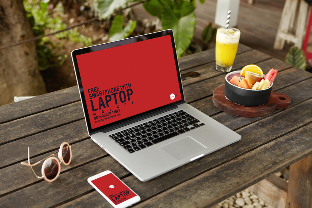 Free-Smartphone-With-Laptop-Mockup-Placing-on-Wooden-Table