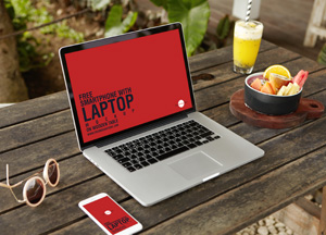 Free Smartphone With Laptop Mockup Placing on Wooden Table