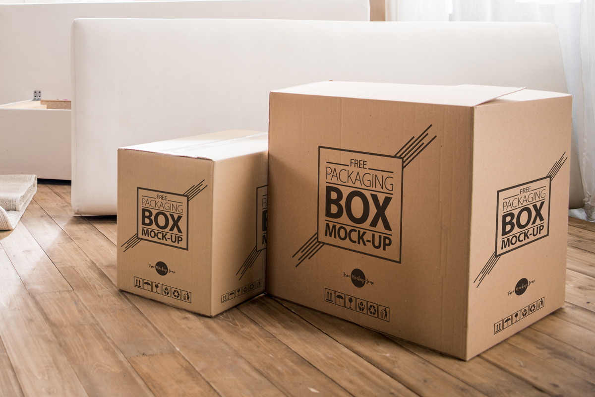 Free-Packaging-Box-on-Wooden-Floor-PSD-Mockup