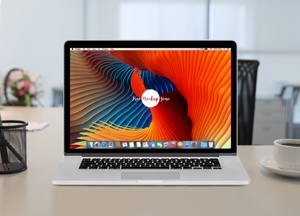 Free Apple MacBook Pro Retina on Workstation Mockup