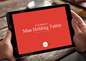 Free Realistic Man Holding Tablet Mockup