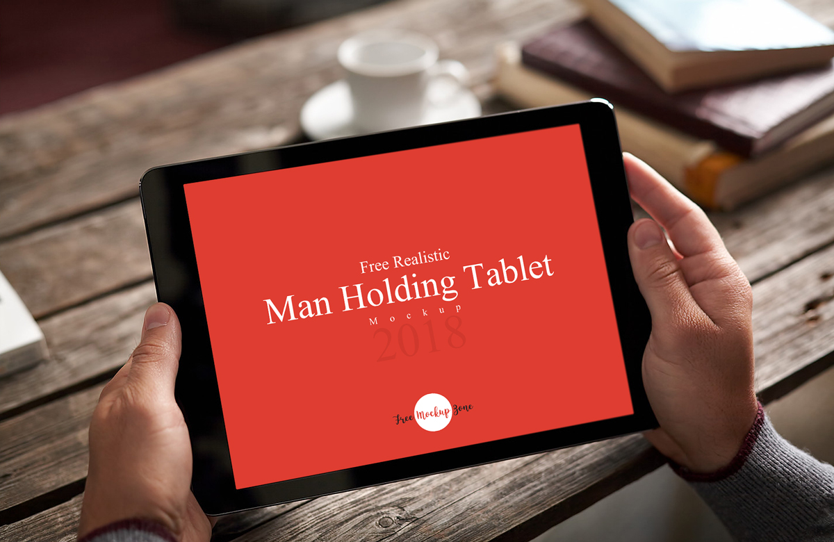 Free-Realistic-Man-Holding-Tablet-Mockup
