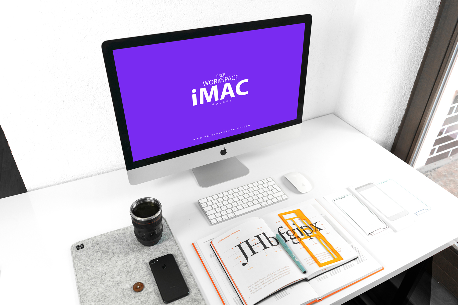 Free-iMac-on-Designer-Workspace-Mockup-2018