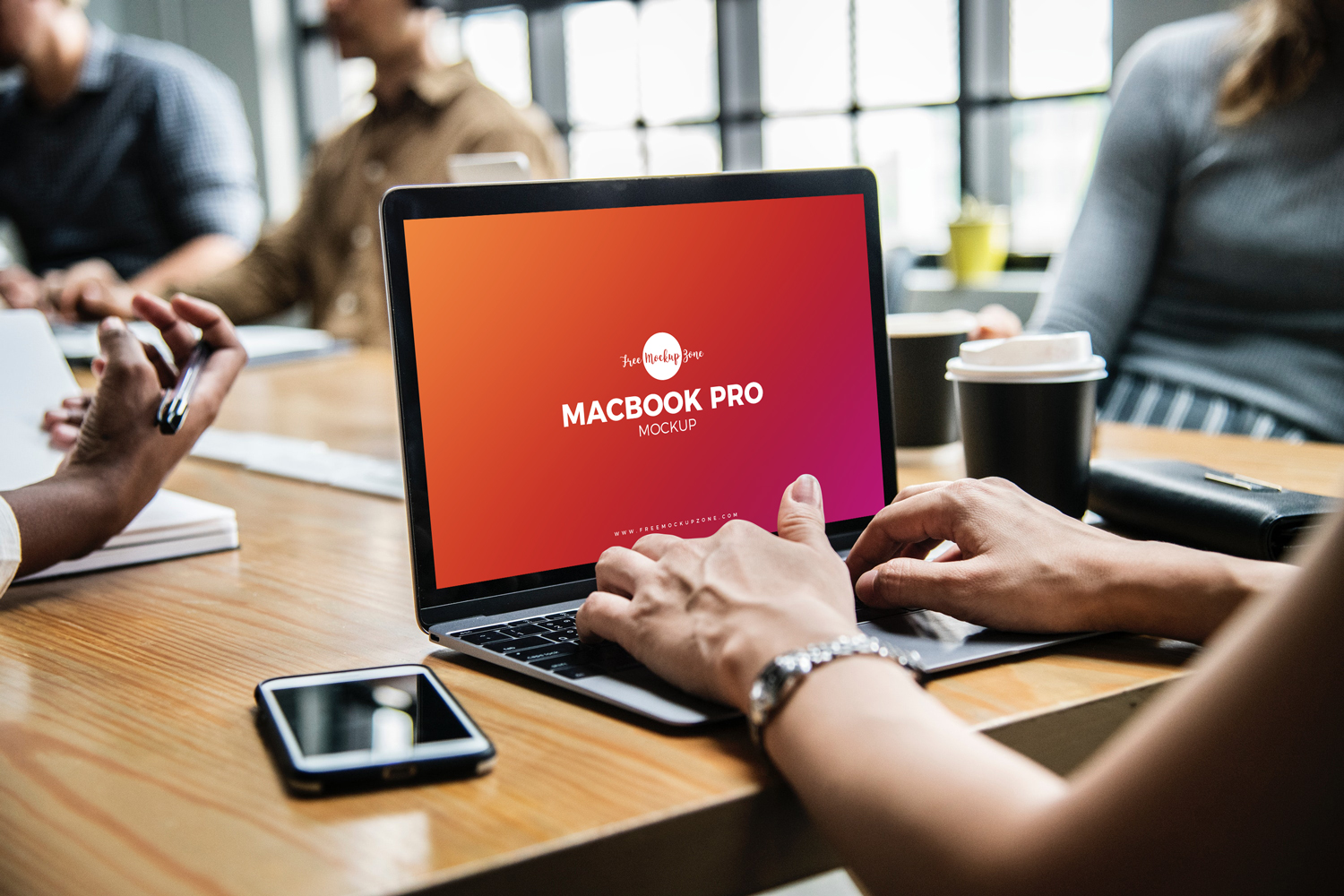 Free-Person-Using-MacBook-Pro-Mockup-PSD-2018