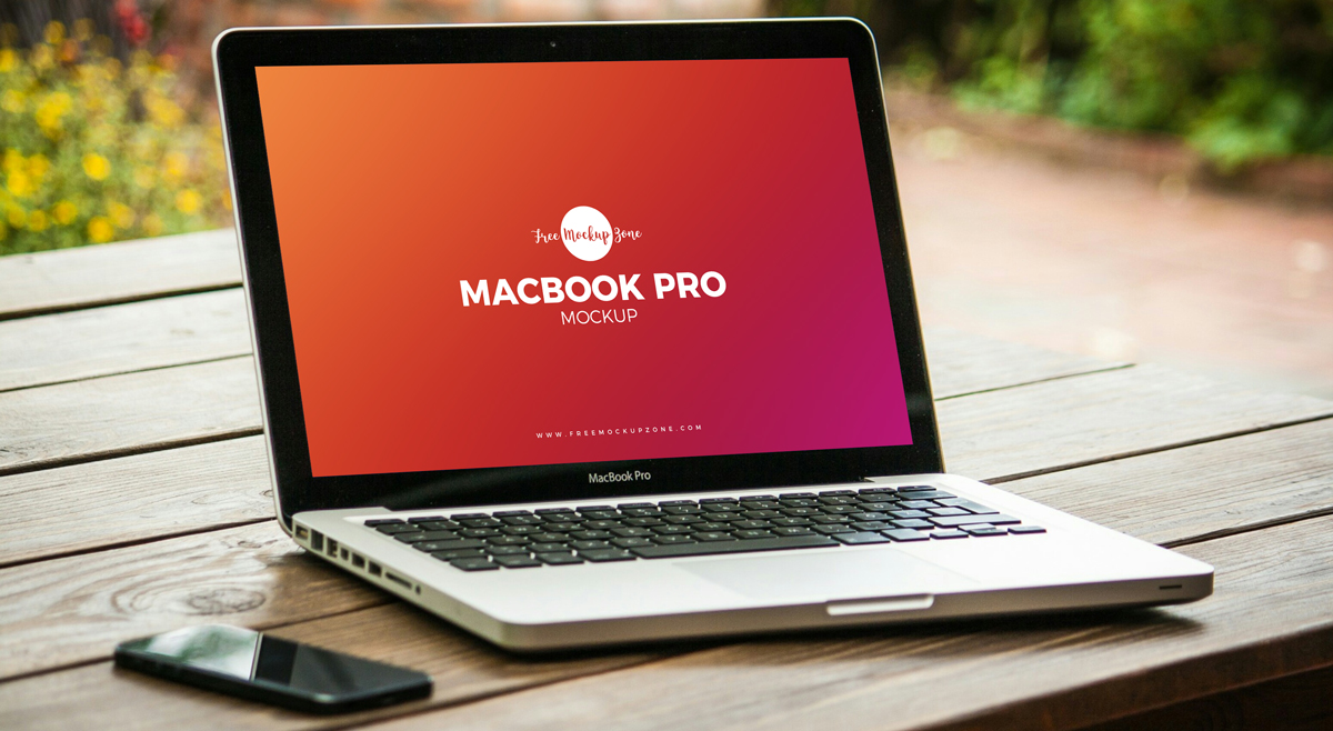 Free-MacBook-Pro-on-Wooden-Table-Mockup-PSD