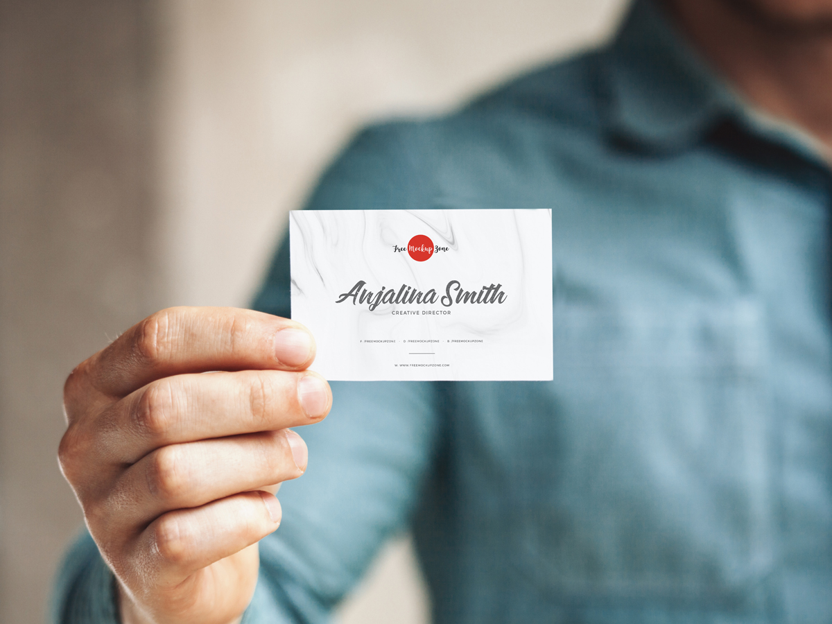 Free-Man-Holding-in-Hand-Business-Card-Mockup-PSD-2018
