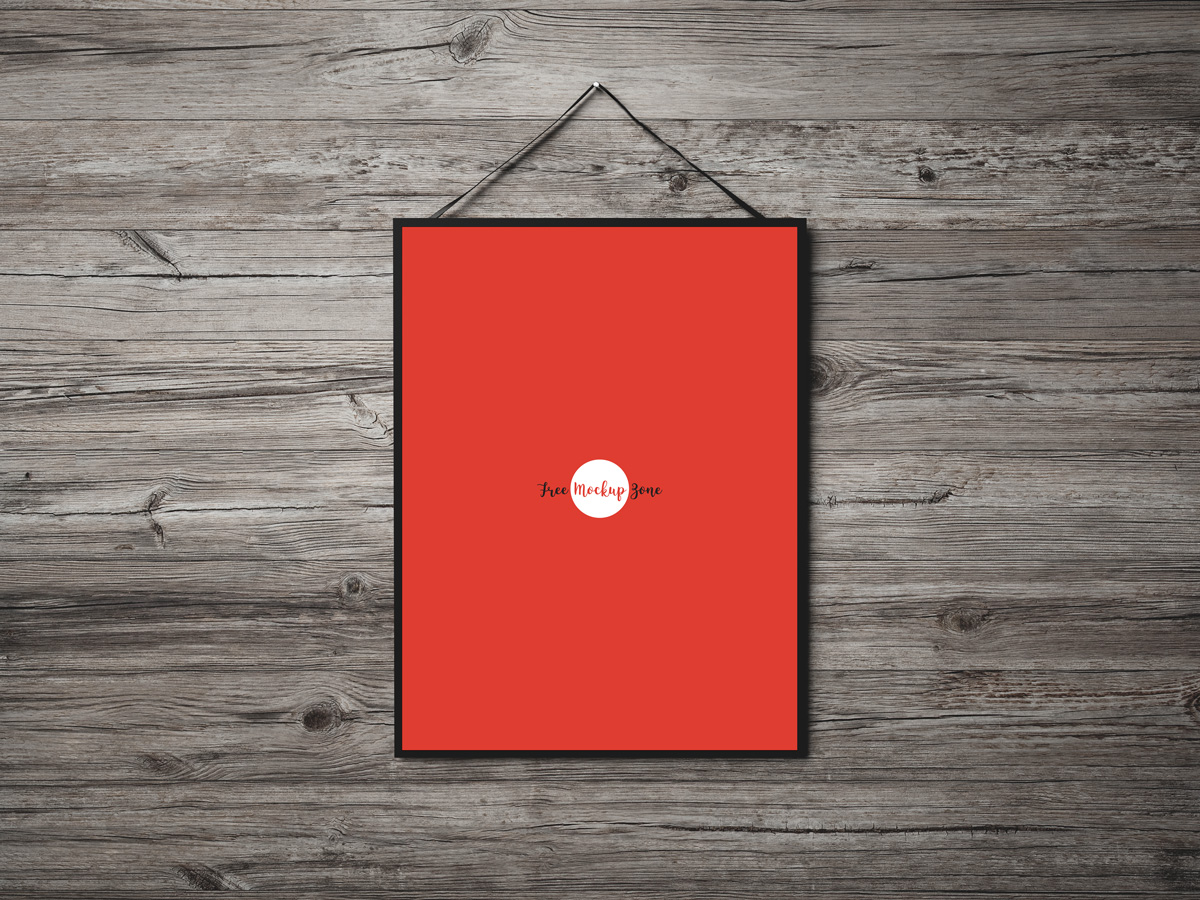 Free-Poster-Hanging-on-Wooden-Wall-Mockup-PSD