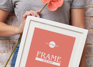 Free-Girl-Showing-PSD-Frame-Mockup-Design-300.jpg