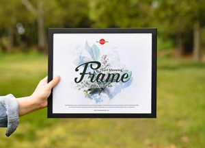 Free-Girl-Showing-Frame-Mockup-PSD-300.jpg