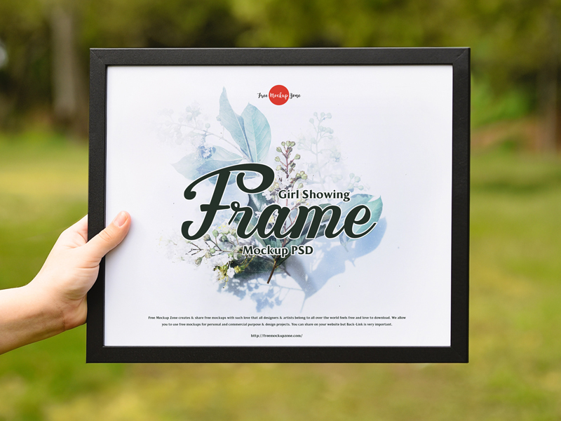 Free-Girl-Showing-Frame-Mockup-PSD-600
