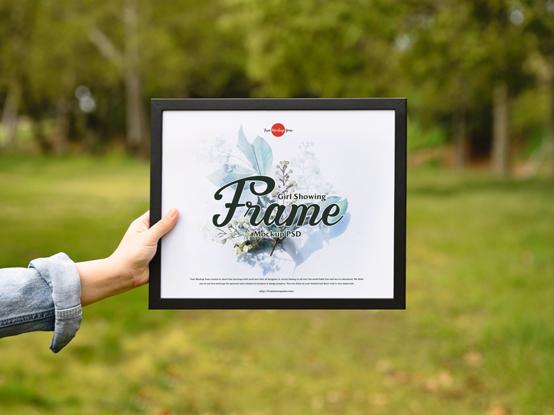Free-Girl-Showing-Frame-Mockup-PSD