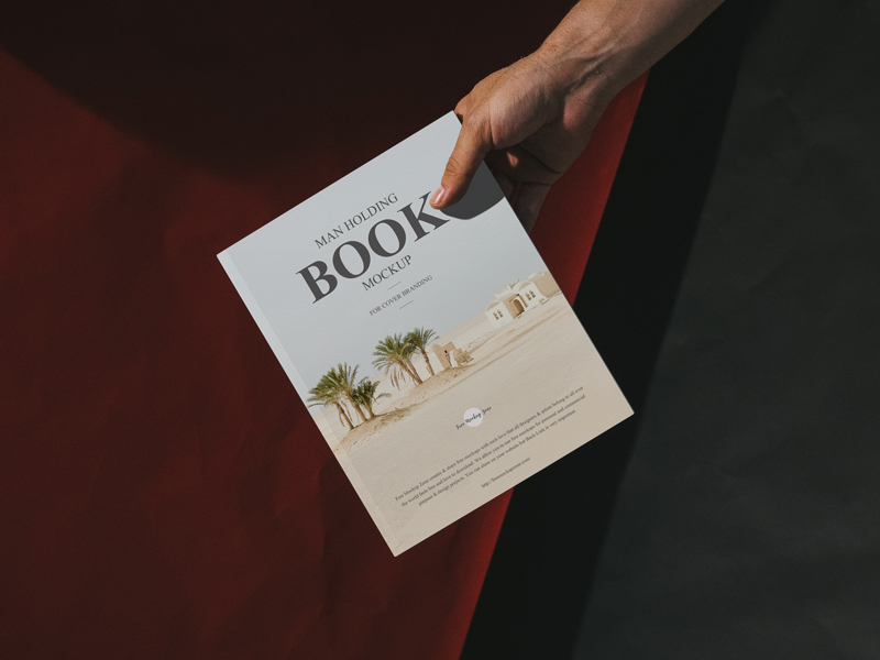 Free-Man-Holding-Book-Mockup-For-Cover-Branding