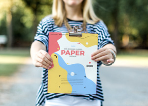 Free-Girl-Showing-Clipped-Paper-Mockup-300.jpg