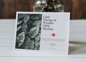 Free-Card-Placing-on-Wooden-Table-Mockup-300.jpg
