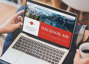 Free-Man-Using-MacBook-Air-Mockup-300.jpg