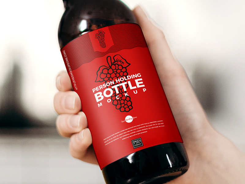 Free-Person-Holding-Bottle-Mockup-600