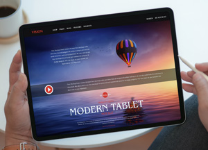Free-Person-Using-Modern-Tablet-Mockup-300.jpg