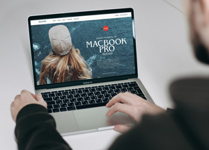 Free-Person-Working-on-MacBook-Pro-Mockup-300.jpg