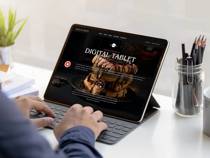 Free-Person-Working-on-Digital-Tablet-Mockup