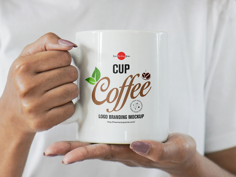 Free-Girl-Holding-Coffee-Cup-For-Logo-Branding-Mockup-600