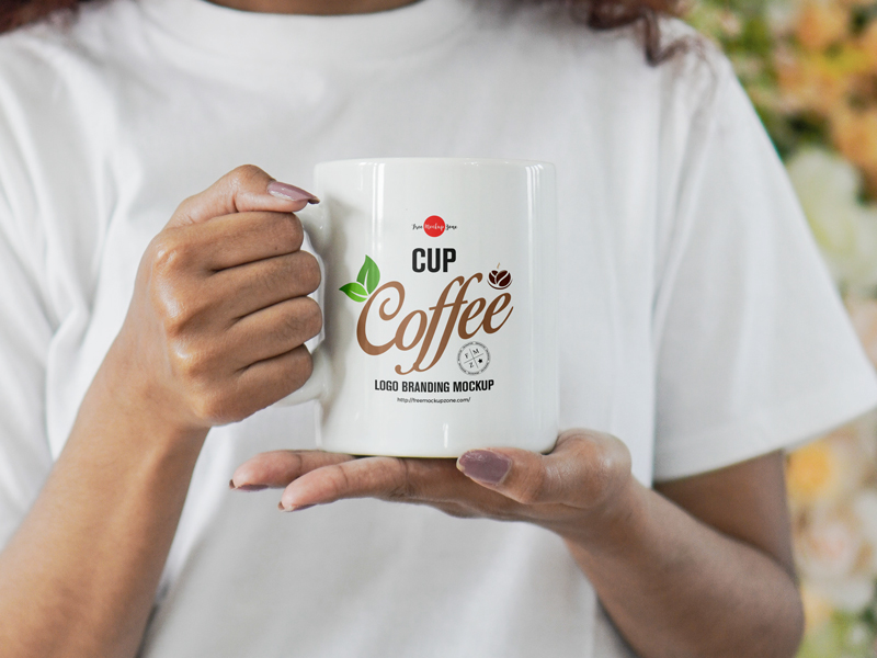 Free-Girl-Holding-Coffee-Cup-For-Logo-Branding-Mockup
