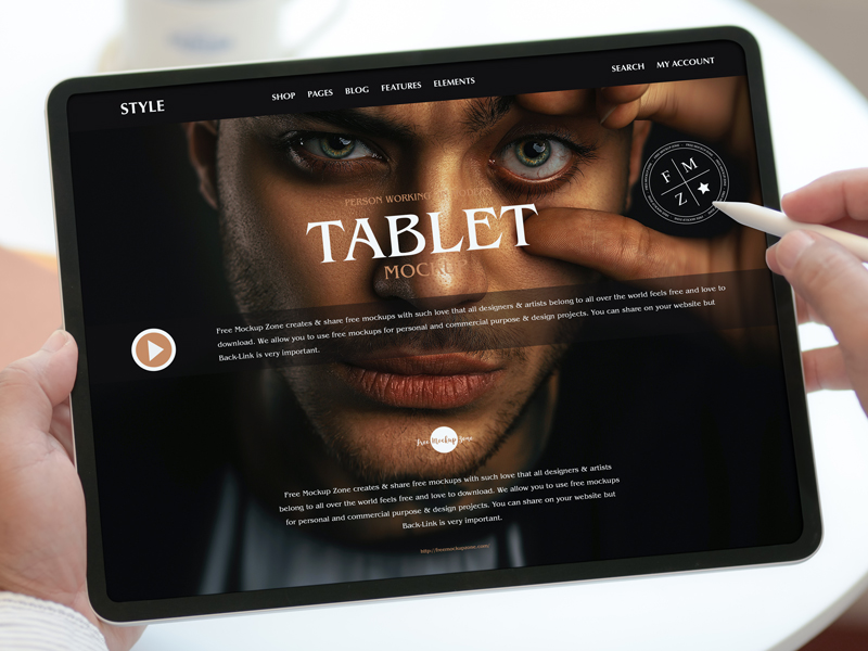 Free-Person-Working-on-Modern-Tablet-Mockup-600