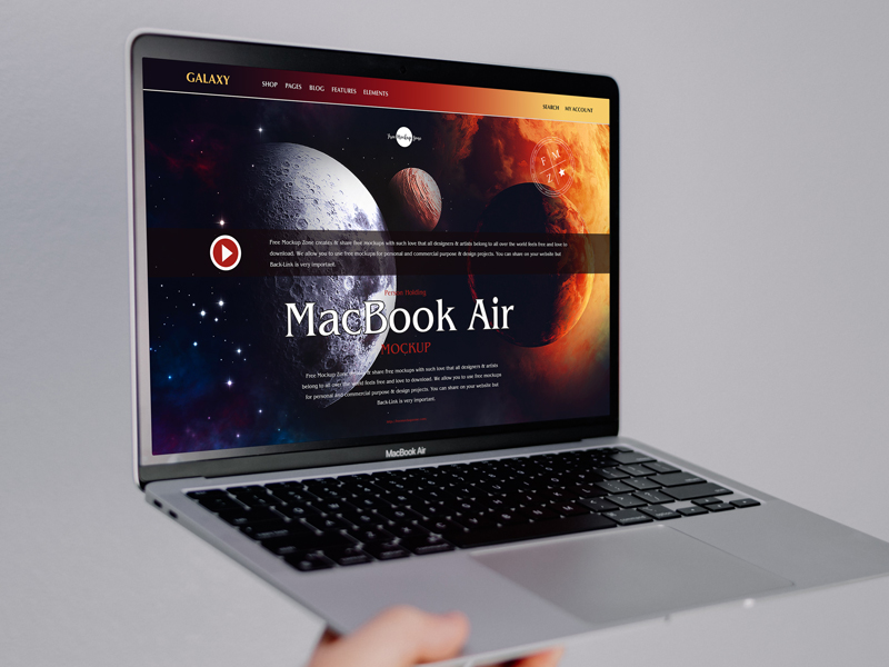 Free-Person-Holding-MacBook-Air-Mockup-600