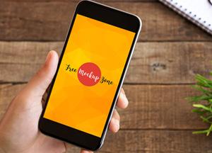 Hand-Holding-Clean-Smartphone-Mockup.jpg