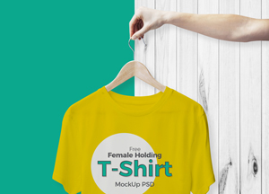 Cool-Female-Holding-T-Shirt-Mockup-For-Branding.jpg