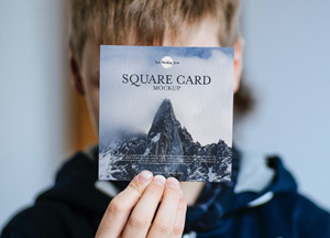Free-Little-Boy-Showing-Square-Card-Mockup-PSD-300.jpg