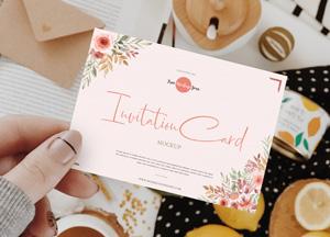 Free-Girl-Showing-Invitation-Card-Mockup-300.jpg
