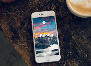 Free-iPhone-With-Coffee-Cup-Mockup-300.jpg