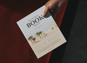 Free-Man-Holding-Book-Mockup-For-Cover-Branding-300.jpg