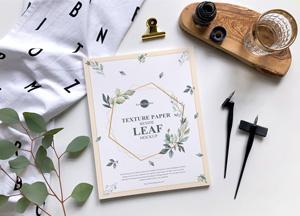 Free-Texture-Paper-Beside-Leaf-Mockup-300.jpg