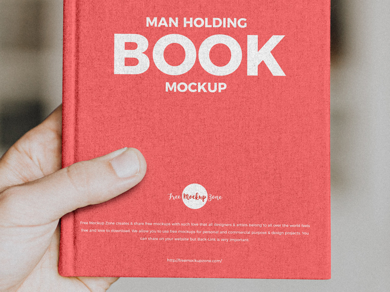 Free-Man-Holding-Book-Mockup-600