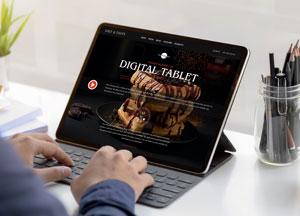 Free-Person-Working-on-Digital-Tablet-Mockup-300.jpg