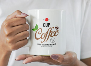 Free-Girl-Holding-Coffee-Cup-For-Logo-Branding-Mockup-300.jpg